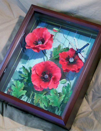 This deep shadow box was ideal, as it doubled as a showcase to display the sugar poppies and as a protectant of these delicate flowers. (8/2010)