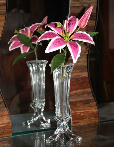 The Stargazer Lily. A sugar flower displayed in a glass bud vase.